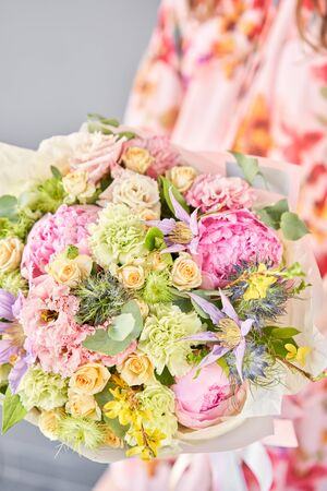 Beautiful bouquet of mixed flowers in woman hand. Floral shop concept . Handsome fresh bouquet. Flowers delivery. Standard-Bild - 150496957