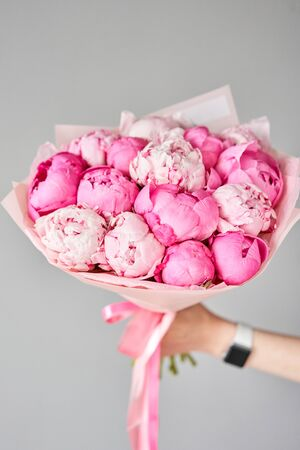 Beautiful bouquet of mixed flowers in woman hand. Floral shop concept . Handsome fresh bouquet. Flowers delivery. Standard-Bild - 150497047