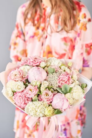 Beautiful bouquet of mixed flowers in woman hand. Floral shop concept . Handsome fresh bouquet. Flowers delivery. Standard-Bild - 150497067