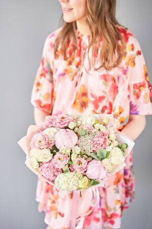 Beautiful bouquet of mixed flowers in woman hand. Floral shop concept . Handsome fresh bouquet. Flowers delivery. Standard-Bild - 150496369