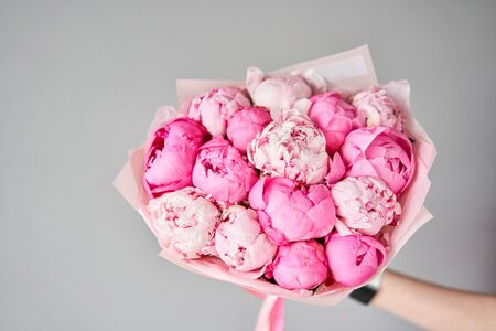 Beautiful bouquet of mixed flowers in woman hand. Floral shop concept . Handsome fresh bouquet. Flowers delivery. Standard-Bild - 150497064