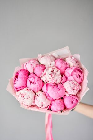 Beautiful bouquet of mixed flowers in woman hand. Floral shop concept . Handsome fresh bouquet. Flowers delivery. Standard-Bild - 150497070