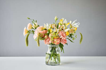 step by step installation of flowers in a vase. Flowers bunch, set for home. Fresh cut flowers for decoration home. European floral shop. Delivery fresh cut flower.