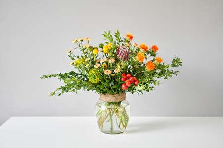 flowers in a vase. Flowers bunch, set for home. Fresh cut flowers for decoration home. European floral shop. Delivery fresh cut flower. Standard-Bild