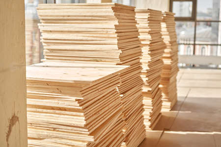 Plywood boards on the industry. layer of plywood, Construction site preparation for the flooring of the parquet floor. Restoration of the floor in a restaurant or apartment.