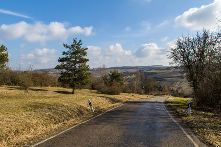 foreground: Spring landscape with a road in the foreground. Stock Photo