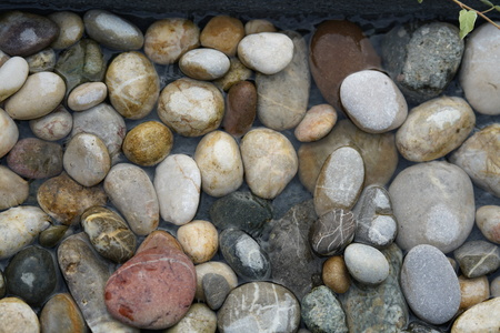 River pebbles in flowing water Stock Photo