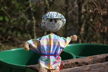 Scarecrow wearing a hat and a smile Stock Photo
