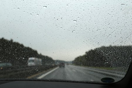 Road from car window  highway in rainy weather
