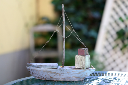 Homemade toy boat is on the table