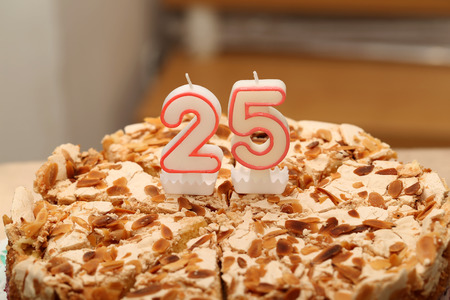 Birthday cake with candle as a number twenty five