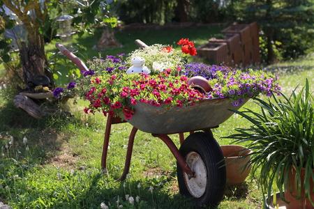 Garden Decoration  Wheelbarrow with flowers Lizenzfreie Bilder