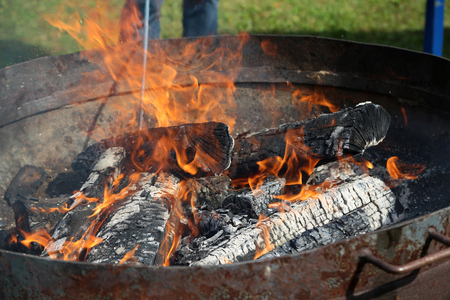 A close up of charcoal on a barbecue
