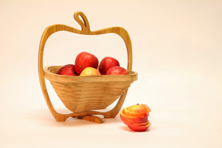 Autumn still life / Apple in a basket Standard-Bild - 111689794
