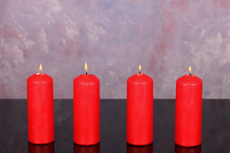 Advent Season, four candles burning. Advent background. Stock Photo