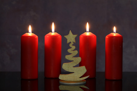 Advent Season, four candles burning. Advent background. Standard-Bild - 110763769