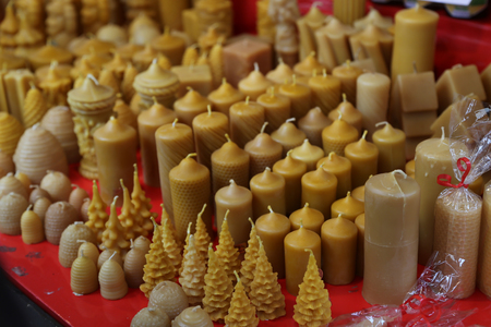 Candles made of wax in the shop window Standard-Bild
