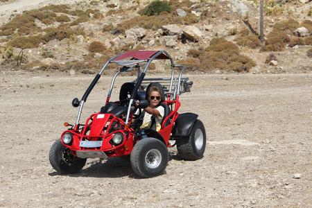 A young man controls a buggy Standard-Bild - 115687180