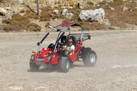 A young man controls a buggy Standard-Bild - 115687182