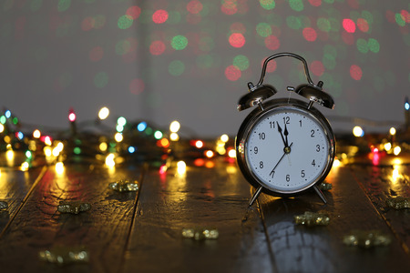 Alarm clock  A few minutes left before the New Year Stock Photo
