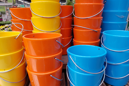 Bright Colored Buckets Multicolored plastic buckets for sale Standard-Bild - 111689630