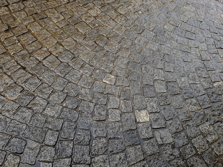 City. old cobbled surface of the road. Standard-Bild - 111689635