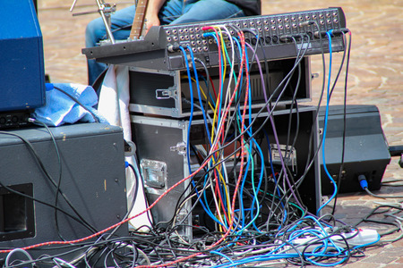 Closeup of standard black audio cables rolling into bundles, studio equipment concept Standard-Bild - 115687124