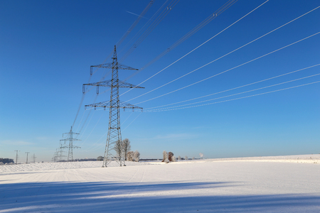 Transmission line on blue sky background Standard-Bild - 115687041