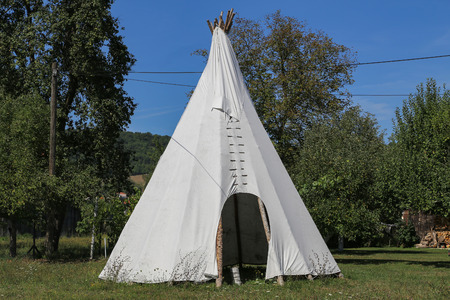 Wigwam in american style pitched in the field