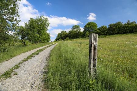 Electric fence in the field Standard-Bild - 107990685