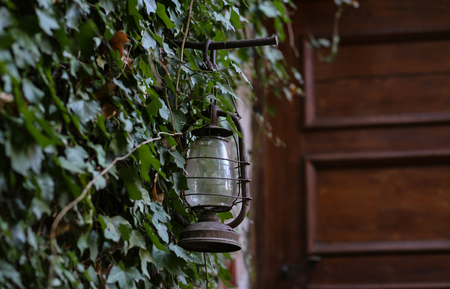Old kerosene lamp at the entrance to the House. Standard-Bild - 114621196