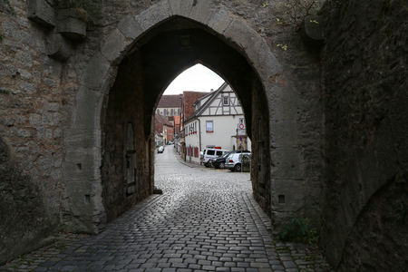 Town of Rothenburg ob der Tauber, Germany. Gate in the fortress wall. Standard-Bild - 116009300