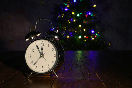 Composition with an alarm clock and a Christmas tree.