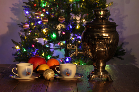 Christmas composition with dressed Christmas tree in the background. Standard-Bild - 114667219