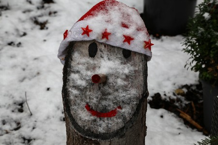 Chump with a face dressed in a New Years cap. Standard-Bild - 114667224