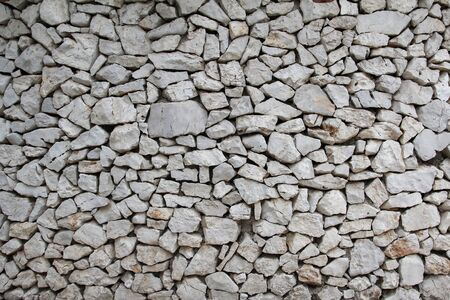 The wall of the house made of natural gray stone Stock fotó