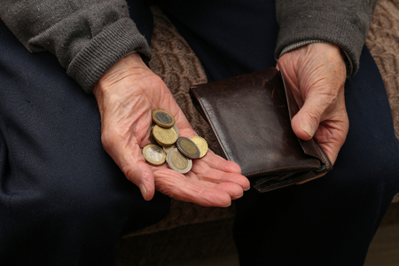 Pension  Money in the hands of an old man Stock Photo