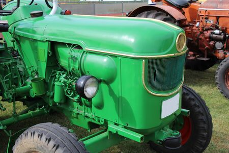 Green tractor at an agricultural exhibition
