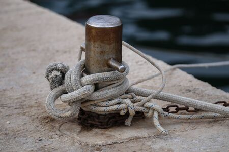 Bollard with a mooring line wrapped around it