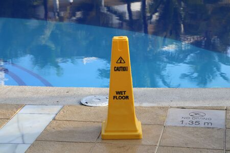 Yellow column near the pool, warns of danger