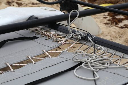 Rope-bound tarpaulin on a catamaran