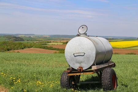 Tank with water in the field