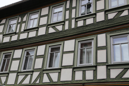 Tudor style house. Facades of houses in the old style. 免版税图像
