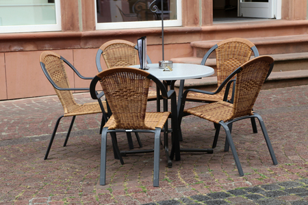 Cozy street restaurant. Tables and chairs in the streets.