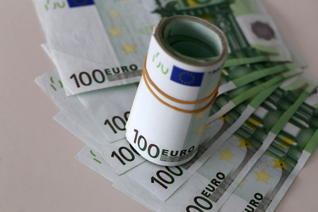 Banknotes worth 100 euros are on the table.