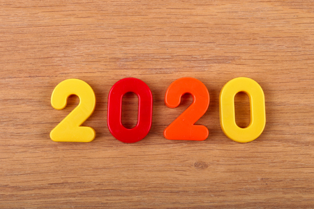 Year 2020 celebrated with multi colored numbers