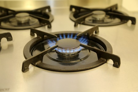 Burning gas, gas stove burner, hob in the kitchen. Archivio Fotografico