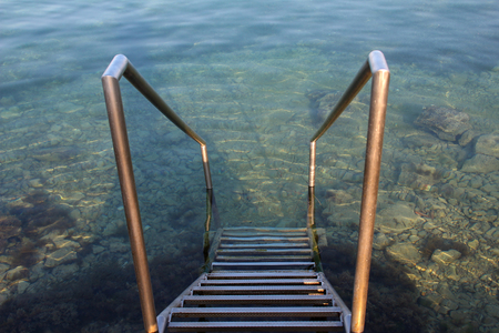 Metal stairs to the entrance of the sea.
