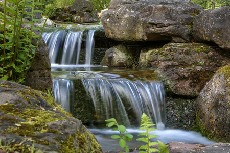 Beautiful waterfalls in the City Park in spring.