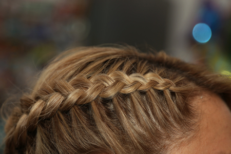 Portrait Of Beautiful Young Blond Woman With Braid Crown Hairstyle. 版權商用圖片